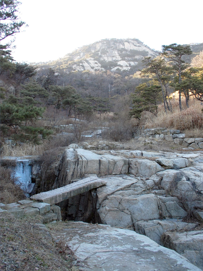 Suseong dong Valley during a cold winter day with a mountain in the background